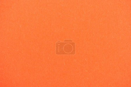 texture of bright orange paper as background