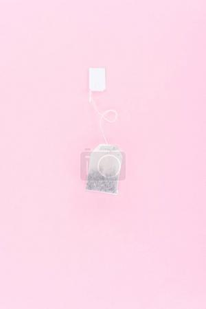 top view of one tea bag isolated on pink