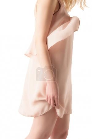 midsection view of girl in elegant pink dress, isolated on white