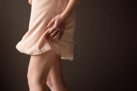 cropped view of girl in elegant chiffon dress, isolated on grey