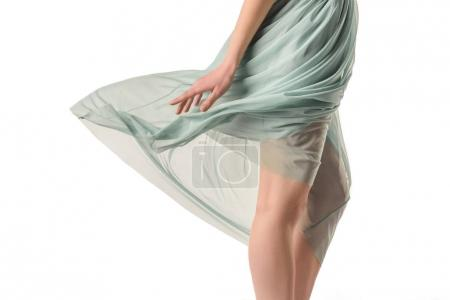 cropped view of elegant girl in transparent waving blue skirt, isolated on white