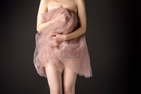 Photo for Partial view of sensual girl posing in pink chiffon dress, isolated on grey - Royalty Free Image