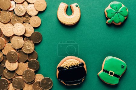 top view of icing cookies and golden coins, st patricks day concept