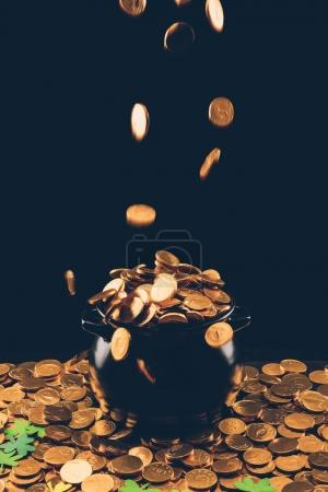 golden coins falling in pot, st patricks day concept