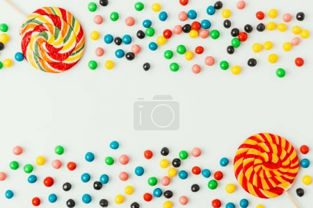 Photo for Top view of arranged lollipops and candies isolated on white - Royalty Free Image