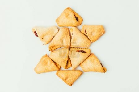 top view of star made of cookies isolated on grey, purim holiday concept