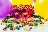 close up view of balloons, masquerade masks and candies, purim holiday concept