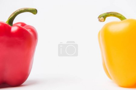 Photo for Red and yellow bell peppers, on white background - Royalty Free Image