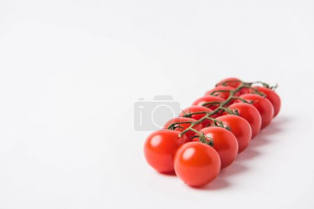Photo for Raw cherry tomatoes laying on white background - Royalty Free Image