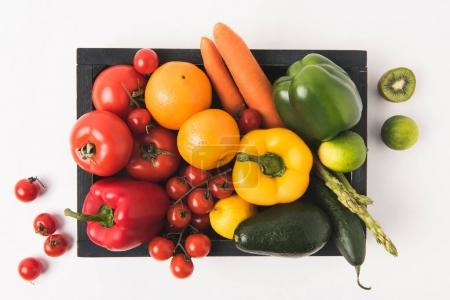 Farmers market concept with vegetables and fruits in dark wooden box isolated on white background