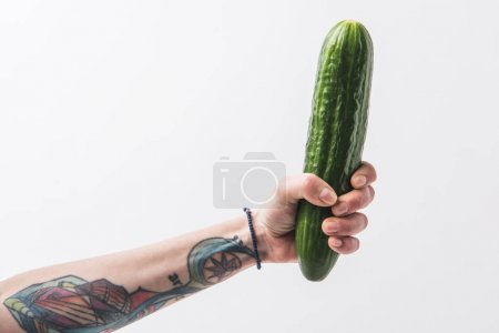 Photo for Hand holding green cucumber isolated on white background - Royalty Free Image