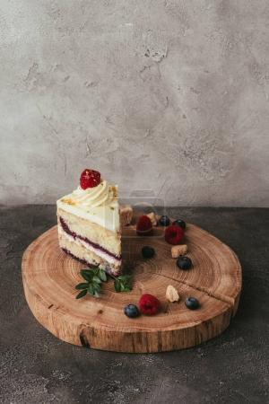 Photo for Piece of delicious fruity cake with whipped cream on wooden board - Royalty Free Image