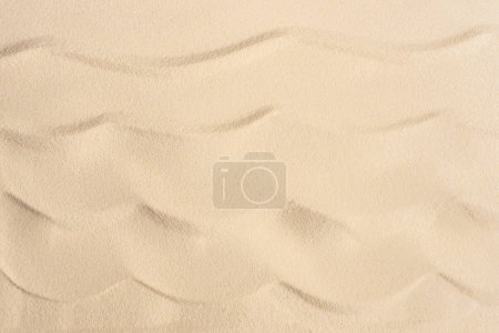 Wavy sandy beach texture for summer travel background