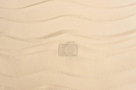 Texture of sandy beach with smooth waves