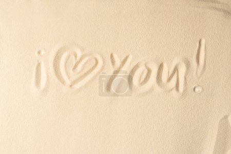I love you inscription on light sand texture