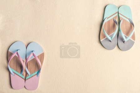 Photo for Colorful flip flops on sandy beach - Royalty Free Image