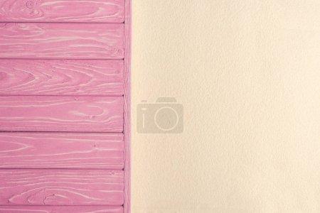 Pink wooden pier on sandy beach