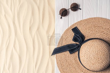 Photo for Straw hat and sunglasses on light sand - Royalty Free Image