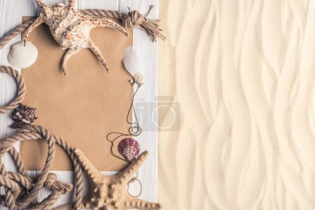 Summer travel template with seashells on sandy beach