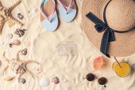 Summer travel objects on light sand