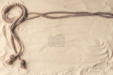 Knotted rope frame on light sand