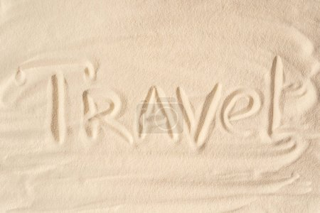 Travel inscription on summer sandy beach