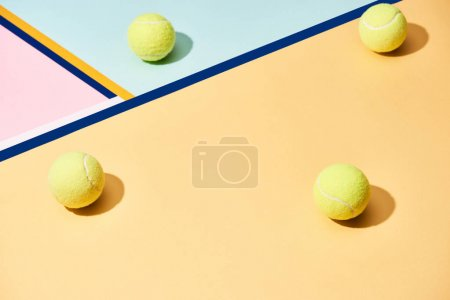 Tennis balls with shadow on colorful background with blue lines