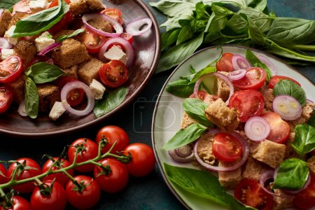 Photo for Fresh Italian vegetable salad panzanella served on plates on table with tomatoes - Royalty Free Image