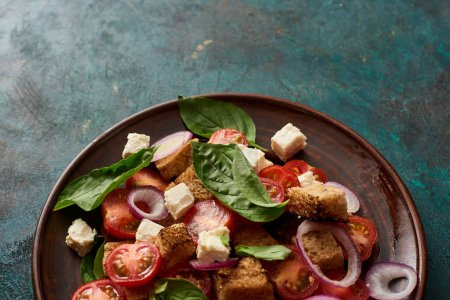 Photo for Fresh Italian vegetable salad panzanella served on plate on table - Royalty Free Image