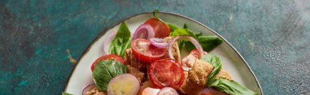 Photo for Top view of fresh Italian vegetable salad panzanella served on plate on table, panoramic shot - Royalty Free Image