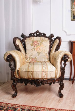Luxury wooden antique chair in the room