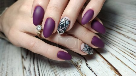 Photo for Trendy manicure design on a beautiful textural background. - Royalty Free Image
