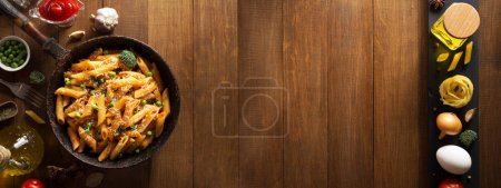 Photo for Ready pasta on wooden background - Royalty Free Image