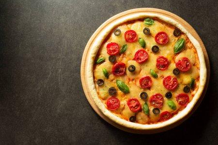 Italian pizza at black background