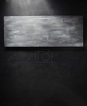 wooden signboard at black background