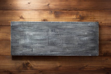 wooden board at brown background