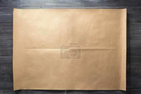 brown of paper at wooden background