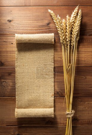 ears of wheat on wood