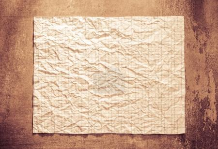wrinkled paper at wall