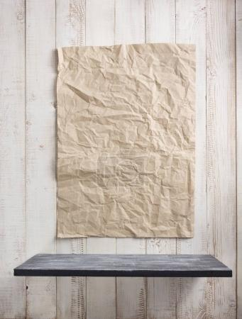 paper and wooden shelf at white background