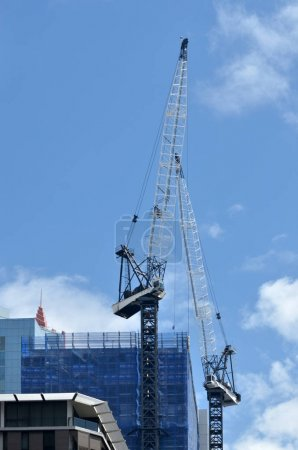 Cranes works in new apartments building block construction site
