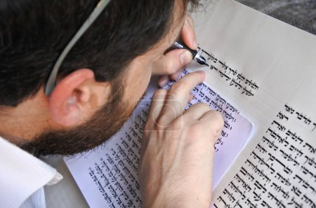 Sofer writes a sefer Torah