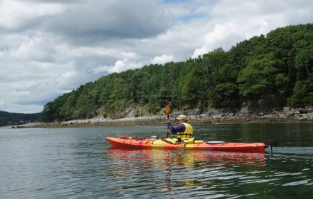 Tourists ride sea kayaks in Bar Harbor, Maine
