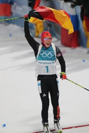 PYEONGCHANG, SOUTH KOREA - FEBRUARY 12, 2018: Olympic champion Laura Dahlmeier of Germany celebrates victory in biathlon women's 10 km pursuit at the 2018 Winter Olympics in Alpensia Biathlon Centre