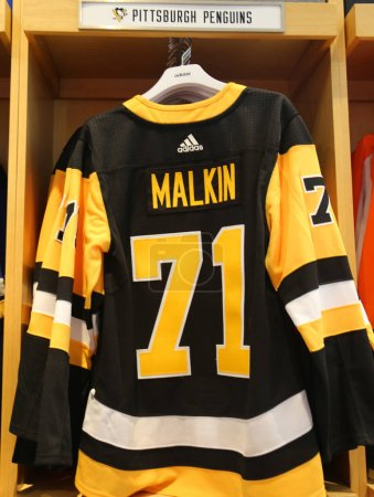 NEW YORK - APRIL 26, 2018: Evgeni Malkin's Pittsburgh Penguins Adidas jersey on display at NHL store in Midtown Manhattan