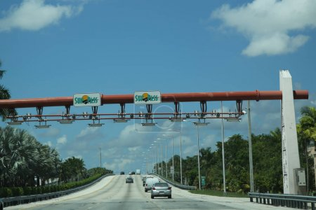 MIAMI, FLORIDA - JUNE 1, 2016: SunPass Overhead Toll System  US-1 South near Miami, Florida