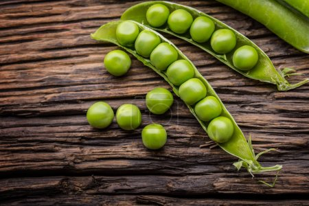 Peas. Fresh bio homemade peas and pods on old oak board. Healthy fresh green vegetable - peas and pods