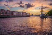 City of Bremen with old sailing ship on Weser river at sunset, Germany