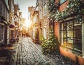 Old town in Europe at sunset with retro vintage Instagram style filter effect