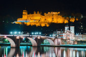 Panoramic view of the old town of Heidelberg reflecting in beautiful Neckar river at night, Baden-Wuerttemberg, Germany